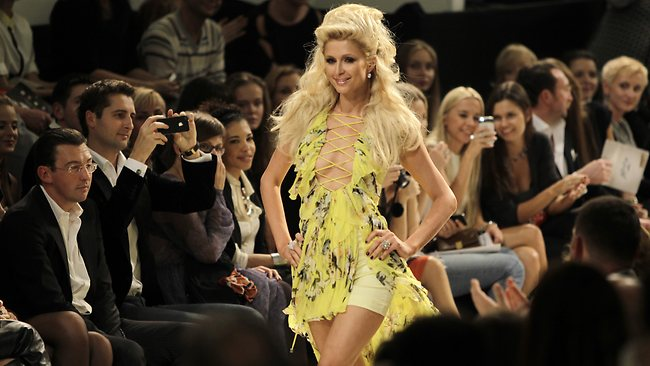 Paris's fashion week ... Paris Hilton displays an outfit by Ukrainian designer Andre Tan during Fashion Week in Kiev.