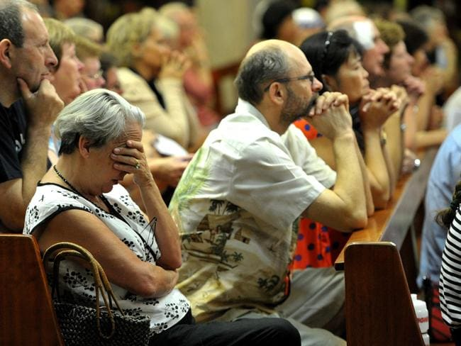 A Service was held at St Marys of the Sea Catholic Cathedral in Darwin to honour the victims and their families of the MH17 Tragedy. The congregation pays its respects.