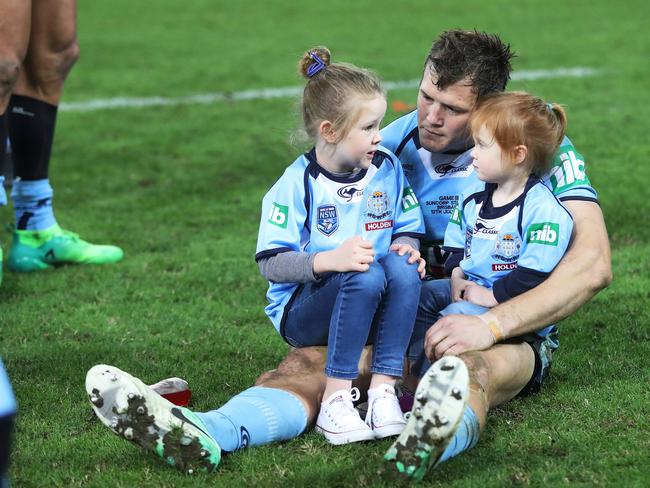 Brett Morris with daughters Emily and Ellie after the loss in the State of Origin series decider at Suncorp Stadium. Picture: Brett Costello