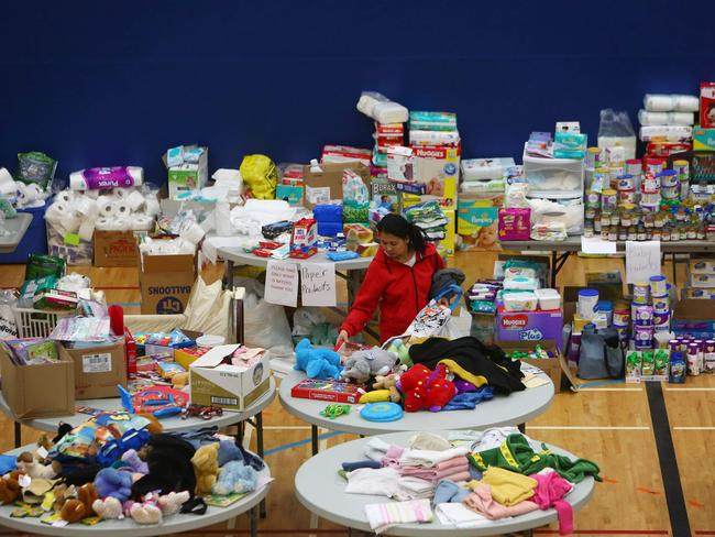 A woman picks through donated clothing and goods at a makeshift evacuee centre in Lac la Biche, Alberta. Picture: AFP
