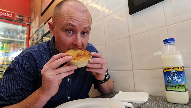 The start: The Daily Telegraph journalist Richard Noone tackles the world's hottest pie. Picture: Peter Lorimer