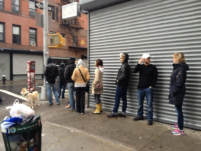 New York residents line up to use a payphone. Picture: Sean Plambeck