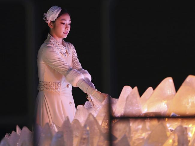 South Korean Olympic figure skating champion Yuna Kim lights the Olympic cauldron. Picture: AP