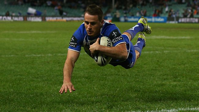 Josh Reynolds dives over to score a try for the Bulldogs during the round 18 NRL match between the Wests Tigers and the Canterbury Bulldogs at Allianz Stadium.