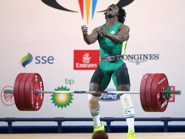 Francois Etoundi of Australia during the 77kg weightlifting competition.