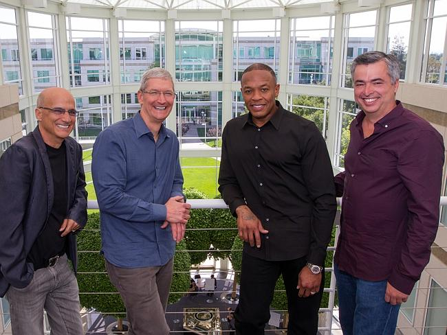 Music entrepreneur and Beats co-founder Jimmy Iovine, Apple CEO Tim Cook, Beats co-founder Dr. Dre, and Apple senior vice president Eddy Cue pose together at Apple headquarters in Cupertino, California.