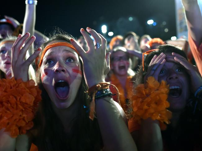 Dutch fans react to the live projection of the quarter-final match between Netherlands and Costa Rica.