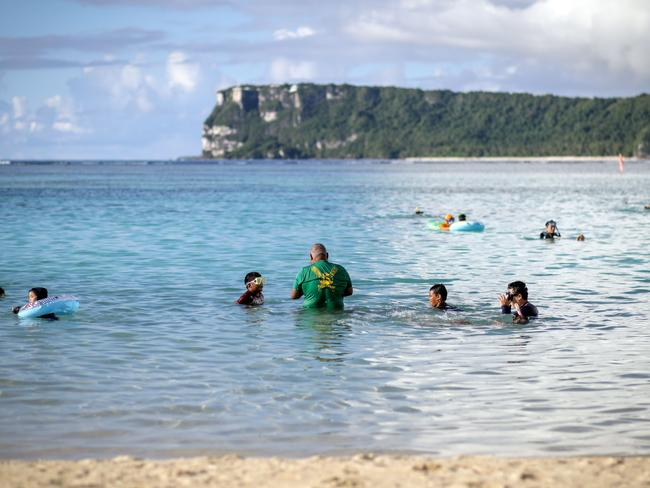 People spend their afternoon along Tumon beach in the city of Tamuning on the island of Guam. Picture: Robert Tenorio/AFP