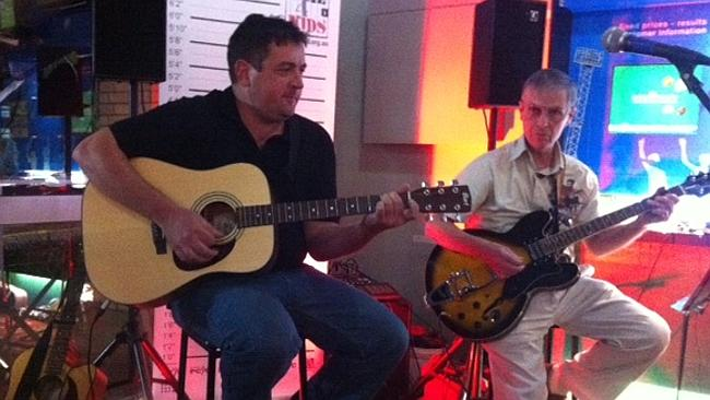 Paul Lockley playing guitar at a local pub recently. Picture: Supplied.