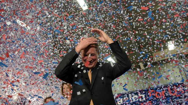 Confetti rains down on John Kasich after he won the winner-takes-all state of Ohio. Picture: AFP/Brendan Smialowski
