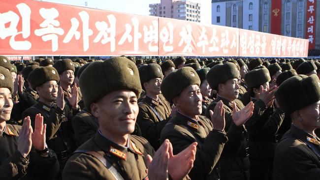 Show of force ... North Korean military personnel clap hands in a rally after North Korea said it had conducted a hydrogen bomb test. Picture: AP/Jon Chol Jin