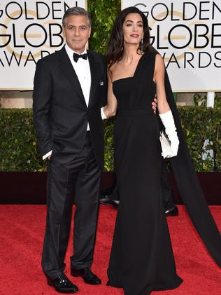 George and Amal Clooney on the red carpet.
