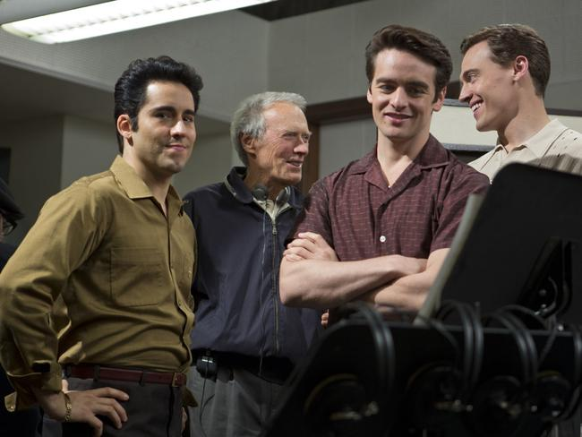 Director Clint Eastwood chats to cast members on the set of  <i>Jersey Boys</i>.