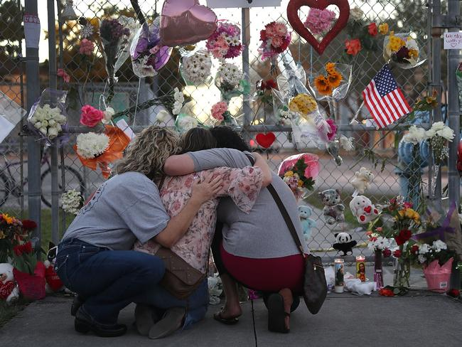 Mourners at a makeshift memorial set up in front of Marjory Stoneman Douglas High School. Picture: AFP