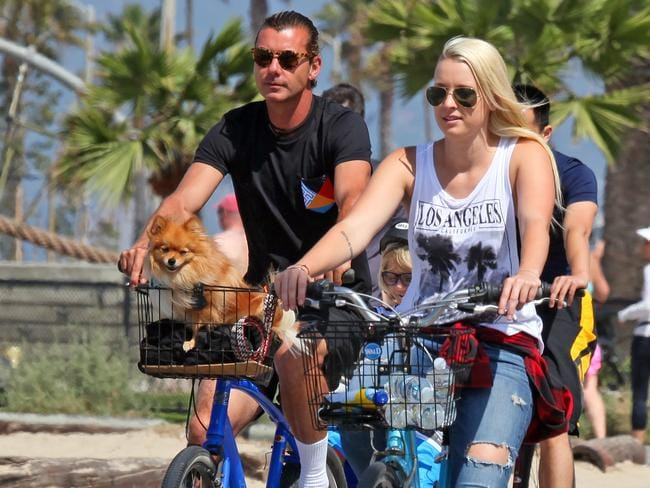 Gavin Rossdale seen biking around Santa Monica with his two sons and nanny Mindy Mann.