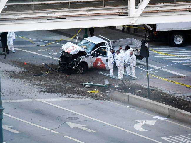 Investigators inspect a truck following a shooting incident in New York. Picture: AFP