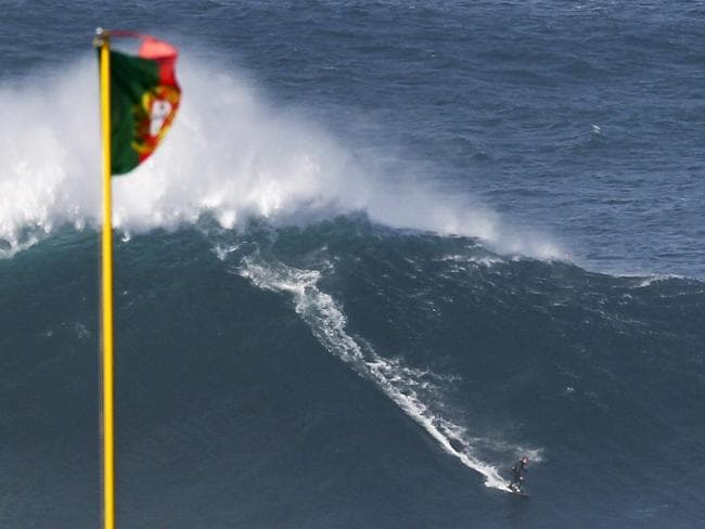 The massive waves are known to reach 80ft (24m) in height. Picture: EPA/PAULO CUNHA