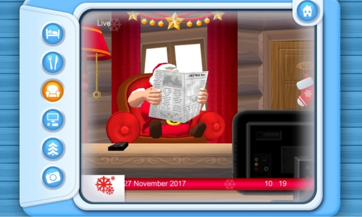 <b>SANTA'S HOME.</b>  <p>This app lets you watch Santa at his home in the North Pole. You can click between his bed, dinner table, the couch, Santa's desk, and an external view of his house. Santa will only be on one of those cameras at a time (duh! not even the big man in red can be in two places at once, right?). You can also play a really cool game where you have to sort toys into coloured baskets. be careful though, it can get quite addictive!</p>