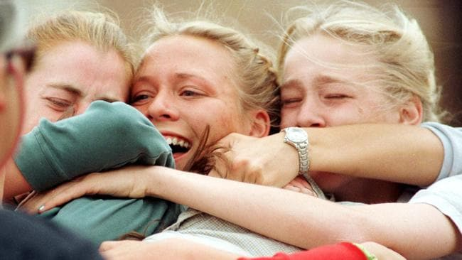 """Mass shooting ... Columbine High School students embracing after being evacuated from the school when two masked teens on a """"suicide mission"""" stormed the school in 1999. Picture: AP"""