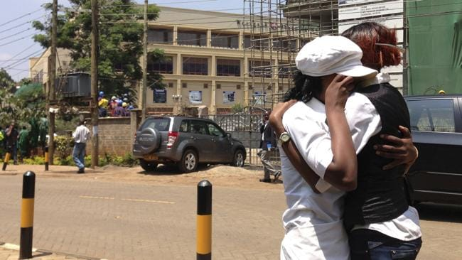 Two women hug outside an upscale shopping mall in Nairobi, Kenya, after a shooting erupted when armed men attempted to rob a store. Picture: AP