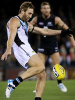 Round 1: Jay Schulz gets a kick away against Carlton at Etihad Stadium. Picture: Colleen Petch.