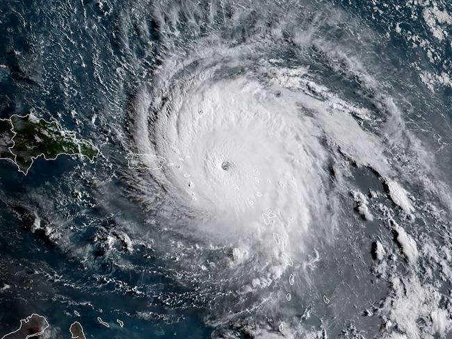 Irma from space on Wednesday as it smashes the Caribbean islands of St Barts and St Martin with winds of more than 300km/h. Picture: AFP PHOTO / NOAA