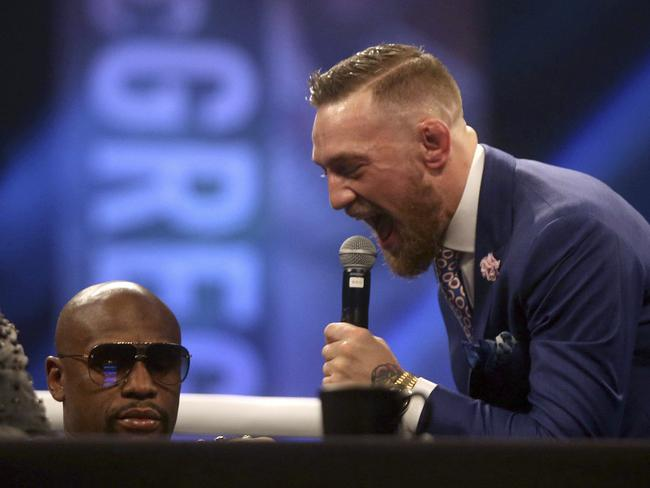 Irish boxer Connor McGregor, right and US boxer Floyd Mayweather.