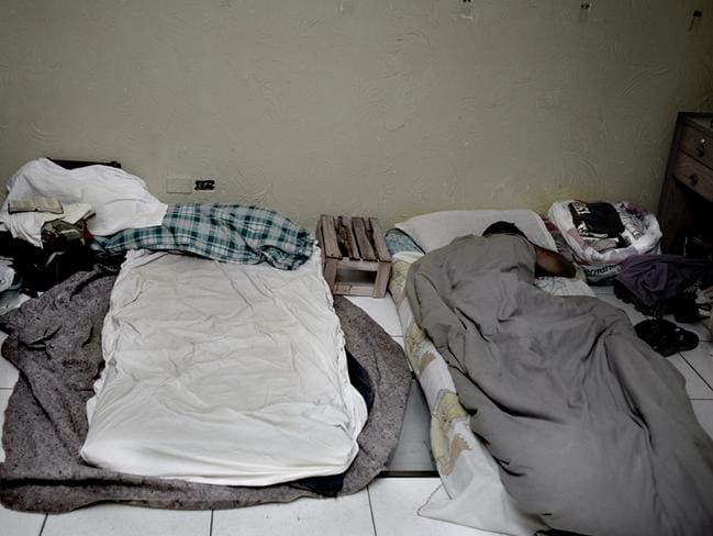 For those who could not get a room, some mattresses and blankets were placed in what used to be a storage room in the second floor. Picture: Felipe Paiva/Newsmodo