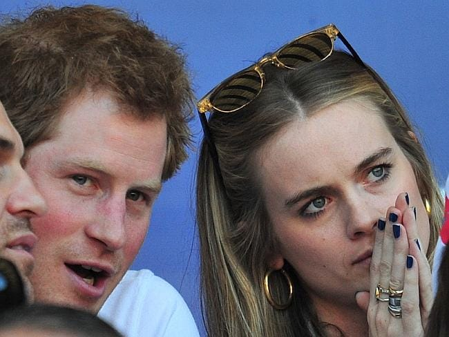 Putting their heads together ... Britain's Prince Harry and Cressida Bonas watching a Six