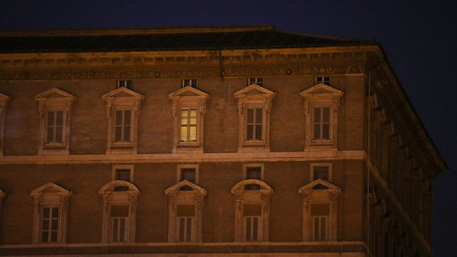 VATICAN CITY, VATICAN - FEBRUARY 28: A solitary light remains switched on in the Papal apartments on February 28, 2013 in Vatican City, Vatican. Pope Benedict XVI has been the leader of the Catholic Church for eight years and is the first Pope to retire since 1415. The Pontiff has flown to Castel Gandolfo where he will cease to be Pope at 20:00 CET local time. He will stay at the Papal Summer residence until renovations are complete at a monastery in the grounds of the Vatican and will be known as Roman pontiff emeritus or pope emeritus. (Photo by Peter Macdiarmid/Getty Images)
