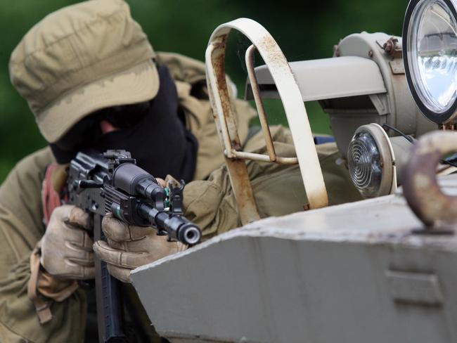 "Attack ... Pro-Russian militants of the ""East"" battalion guard a checkpoint near the eastern Ukrainian city of Donetsk."