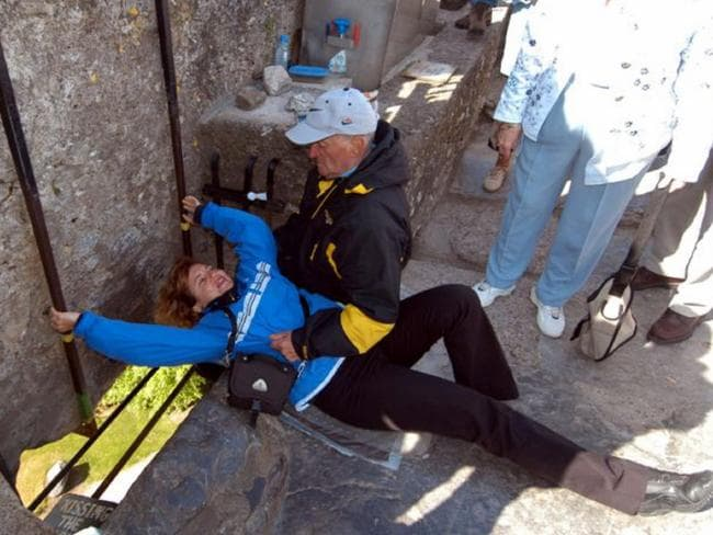 Tourists need to go to a bit of effort to kiss the Blarney stone at Blarney Castle in Ireland.