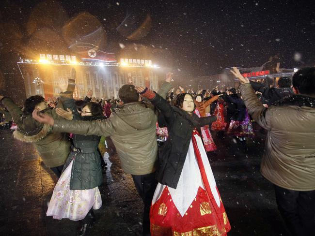 People in Pyongyang danced and watched fireworks the day after a rocket launch that has been strongly condemned by many countries around the world.