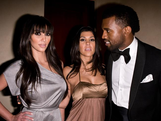 Eye on the prize ... Kim Kardashian, Kourtney Kardashian and Kanye West in 2008.