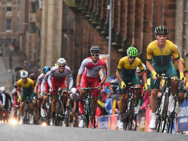 Michael Hepburn (R) of Australia leads the chasing pack in the Men's Road Race.
