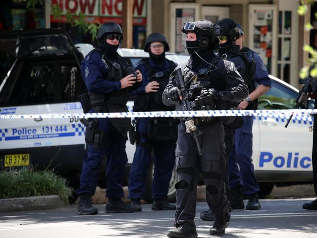 Heavily armed police patrol Argyle Street in Picton. Picture: Jonathan Ng