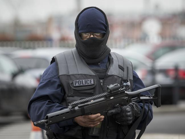 An elite police officer patrols at Orly Airport, south of Paris. Picture: AP