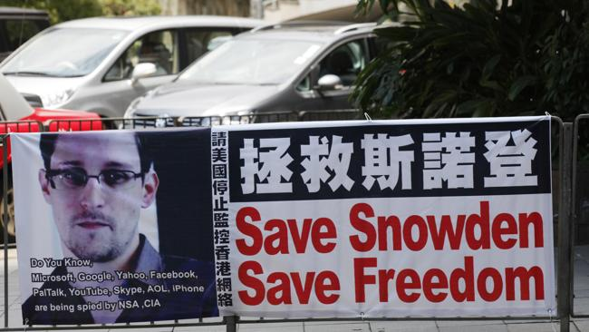 A banner supporting Edward Snowden, a former CIA employee who leaked top-secret documents. (AP Photo/Kin Cheung)