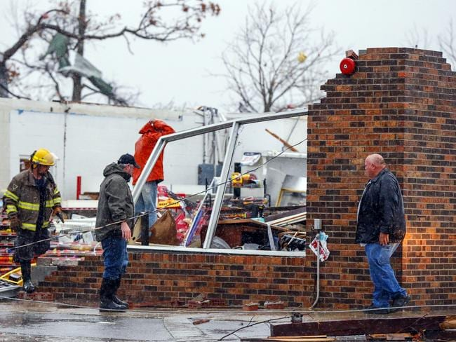 A Rosalie firefighter helps remove debris from the Rosalie Plaza after a tornado ripped through the town. Picture: AP