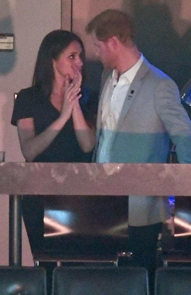 A private moment between Meghan Markle and Prince Harry at the Invictus Games Toronto 2017 in September. Picture: Karwai Tang.