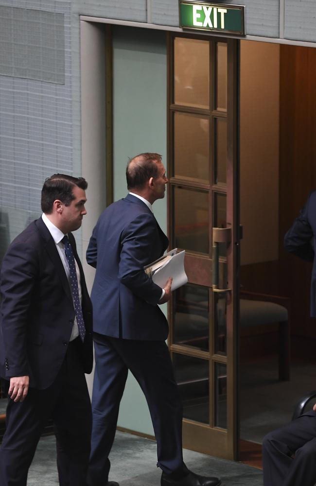 Former Australian prime minister Tony Abbott heads for the exits followed by Michael Sukkar. Picture: AAP Image/Lukas Coch