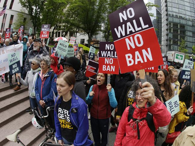 Protesters wave signs and chant during a demonstration against President Donald Trump's revised travel ban outside a federal courthouse in Seattle. Picture: AP