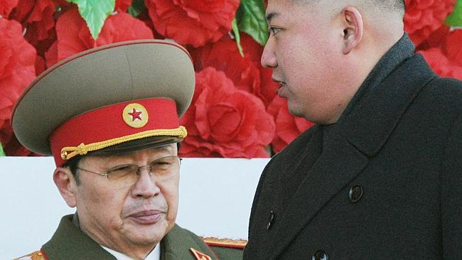 North Korean leader Kim Jong Un walks past his uncle Jang Song Thaek, left, after reviewing a parade of thousands of soldiers...