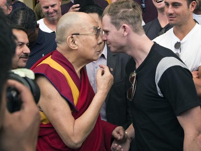 The Dalai Lama rubs noses with Steve Smith at the Tsuglakhang temple in Dharmsala.