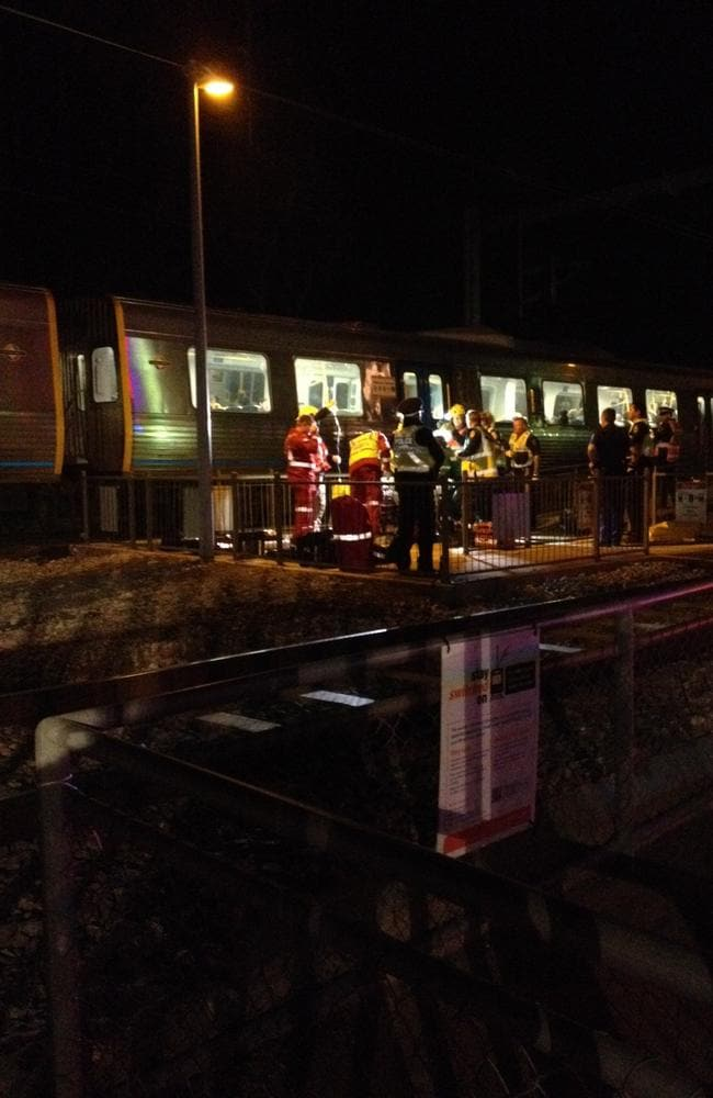 Emergency services at the scene, where a woman has been trapped under a train at Woodlands railway station at Edwardstown