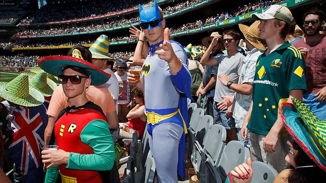 Aussie fans celebrate a wicket on the Boxing Day test. Picture: Jake Nowakowski