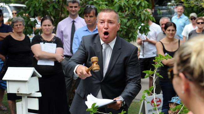 UNSETTLE THE MAN IN CHARGE .... Auctioneer Mark Roberts in full flight at a home in Sydney.