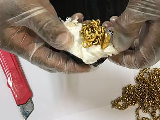 "This handout photo released by the Sri Lanka Customs Office on September 25, 2017 shows a Sri Lankan customs official displaying gold that had been found stuffed in a man's rectum at the country's main international airport in Colombo. Sri Lanka customs arrested an India-bound passenger attempting to smuggle out nearly a kilo (2.2 pounds) of gold biscuits and jewellery stuffed in his rectum, a spokesman said September 25. Officials were alerted when the 45-year-old Sri Lankan man behaved ""suspiciously"" at the departure lounge of the country's main international airport on September 24, spokesman Sunil Jayaratne said. / AFP PHOTO / SRI LANKA CUSTOMS OFFICE / Handout / RESTRICTED TO EDITORIAL USE - MANDATORY CREDIT ""AFP PHOTO / Sri Lanka Customs Office""- NO MARKETING NO ADVERTISING CAMPAIGNS - DISTRIBUTED AS A SERVICE TO CLIENTS"