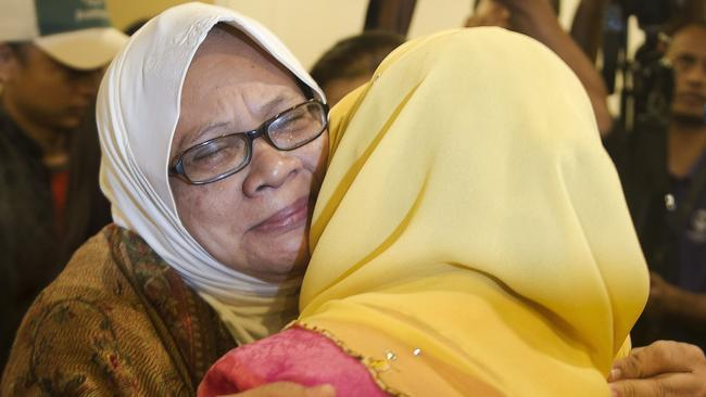 Agony ... a relative of a passenger who was on board MH17 embraces Malaysia's Woman, Family and Community development Minister Rohani Abdul Karim.