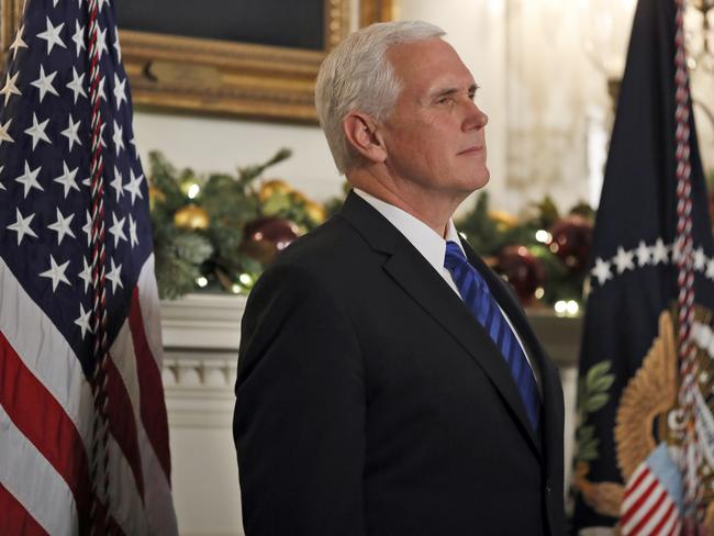 Vice President Mike Pence listens as President Donald Trump speaks in the Diplomatic Reception Room of the White House. Picture: AP